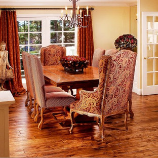 Inspiration for a timeless dark wood floor dining room remodel in Seattle with yellow walls