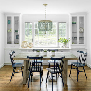 Example Of A Country Dark Wood Floor And Brown Enclosed Dining Room Design In Boston