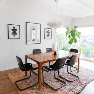 Dining room - mid-sized 1960s medium tone wood floor and brown floor dining room idea in Los Angeles with white walls