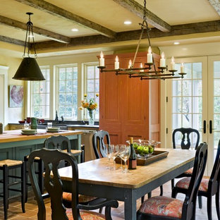 Inspiration for a victorian kitchen/dining room in Burlington with yellow walls.