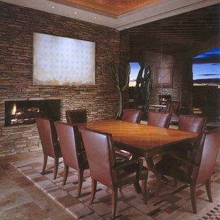 Ejemplo de comedor de estilo americano, grande, cerrado, con paredes beige, suelo de travertino, chimenea de doble cara y marco de chimenea de piedra