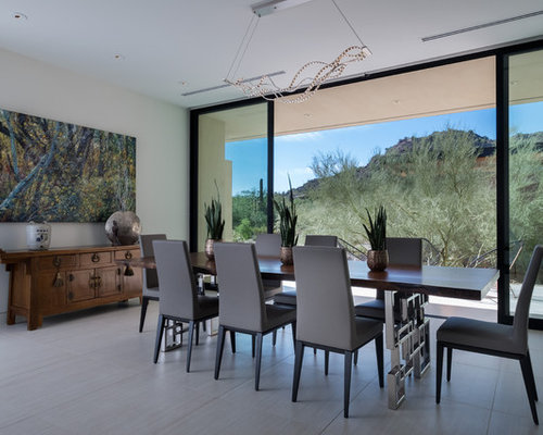 southwest gray floor dining room photo in phoenix with beige walls - Southwestern Design Ideas