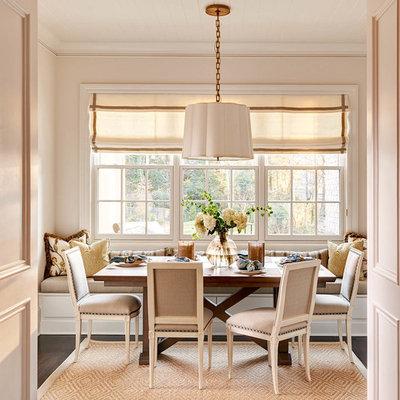 Elegant dark wood floor dining room photo in Charlotte with beige walls