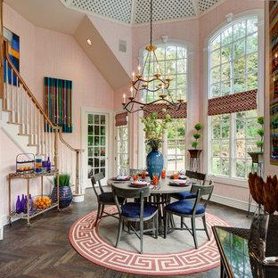 Idée de décoration pour une salle à manger ouverte sur la cuisine bohème de taille moyenne avec un mur orange, un sol en bois foncé et aucune cheminée.