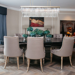 Photo of a medium sized traditional dining room in London with brown walls and brown floors.