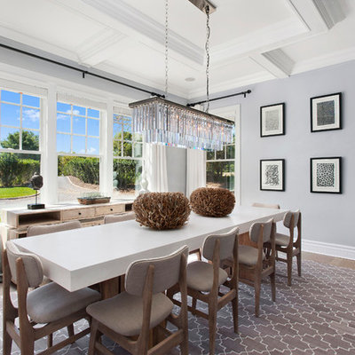 Enclosed dining room - mid-sized transitional medium tone wood floor and beige floor enclosed dining room idea in New York with gray walls