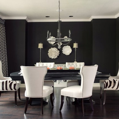 Inspiration for a transitional dark wood floor and brown floor dining room remodel in Kansas City with black walls