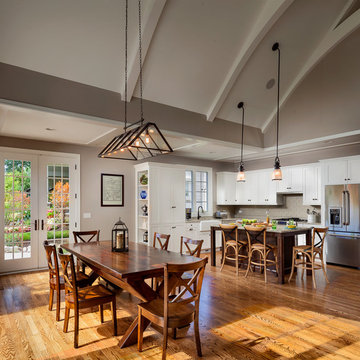 Dine-in room open to kitchen and great room with vaulted ceiling