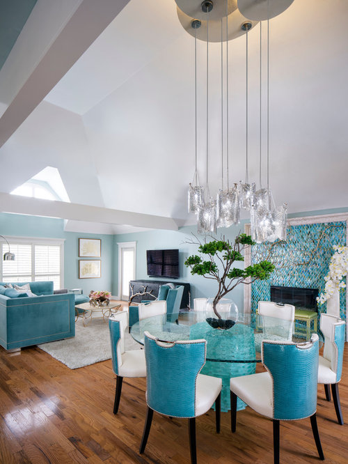 Photo Of A Mid Sized Tropical Open Plan Dining In New Orleans With Blue Walls