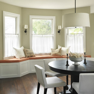 Design ideas for a traditional dining room in Providence with beige walls and dark hardwood floors.