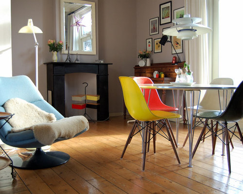 Midcentury Modern Medium Tone Wood Floor Dining Room Photo In Amsterdam With Gray Walls