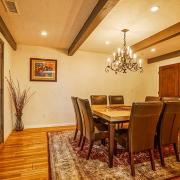 Dining area with Exposed Ceiling Joists.