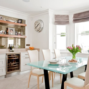 Dining area with wine cooler and floating shelves