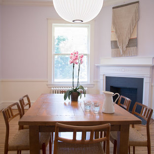 Example of a mid-sized 1950s light wood floor dining room design in Baltimore with white walls and a corner fireplace