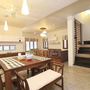Diseño de comedor exótico, de tamaño medio, con paredes blancas y suelo de mármol