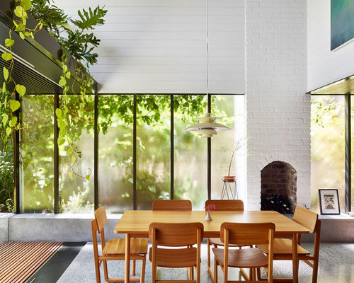 This Is An Example Of A Mid Sized Contemporary Open Plan Dining In Brisbane With