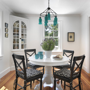 Dining room - beach style medium tone wood floor dining room idea in Providence with white walls