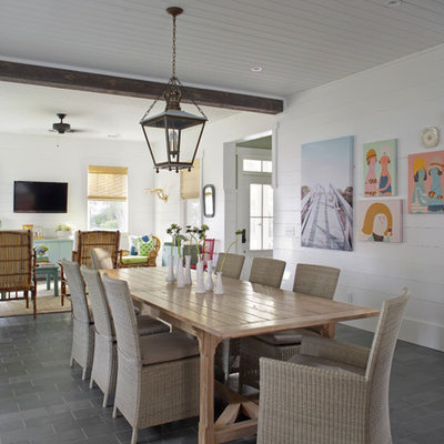 Large beach style slate floor and gray floor great room photo in Atlanta with white walls and no fireplace