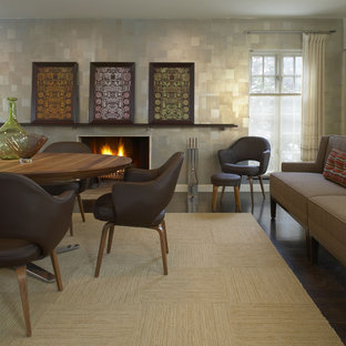 Inspiration for a contemporary dark wood floor dining room remodel in Detroit with a standard fireplace