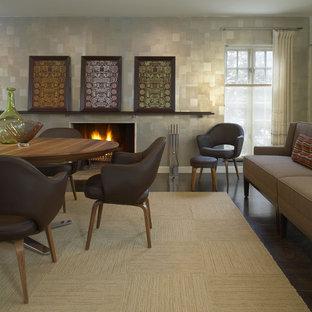 Exemple d'une salle à manger tendance avec un sol en bois foncé et une cheminée standard.