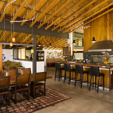Industrial Dining Room by Ryan Group Architects
