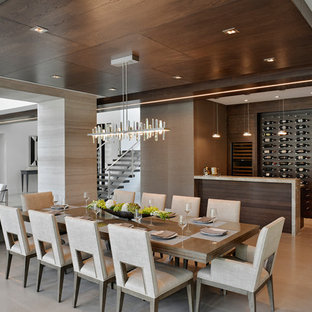 Inspiration for a contemporary beige floor great room remodel in Miami with brown walls and no fireplace