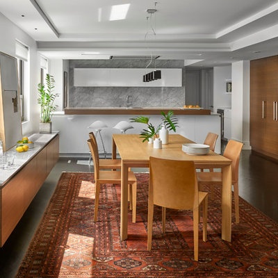 Mid-sized trendy dark wood floor kitchen/dining room combo photo in Chicago with white walls