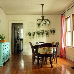 Ispirazione per una sala da pranzo eclettica con pareti bianche