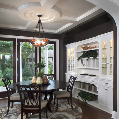 Inspiration for a timeless brown floor dining room remodel in Minneapolis with black walls