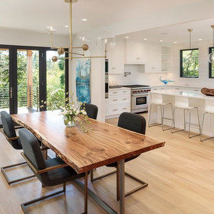 Danish light wood floor kitchen/dining room combo photo in Portland with white walls