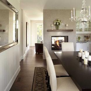 Idéer för vintage separata matplatser, med vita väggar, mörkt trägolv, en dubbelsidig öppen spis, en spiselkrans i gips och brunt golv