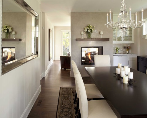 Elegant Dark Wood Floor And Brown Enclosed Dining Room Photo In Minneapolis With White Walls