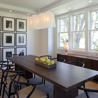 Transitional medium tone wood floor and beige floor dining room photo in Minneapolis with white walls