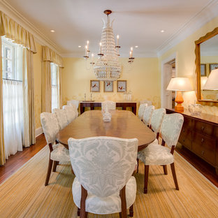 Inspiration for a large timeless medium tone wood floor enclosed dining room remodel in DC Metro with yellow walls
