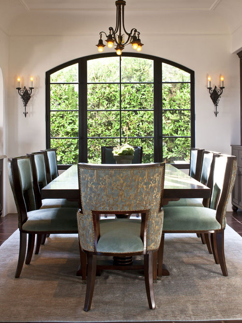 inspiration for a mediterranean ceramic floor dining room remodel in los angeles with white walls