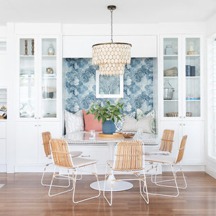 Medium sized nautical kitchen/dining room in Gold Coast - Tweed with white walls, brown floors and vinyl flooring.