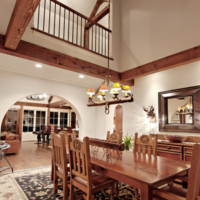 Mountain style dark wood floor dining room photo in Atlanta with white walls