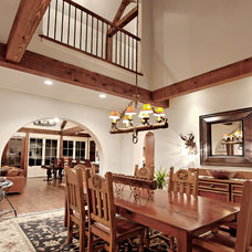 Rustic Dining Room by Dresser Homes