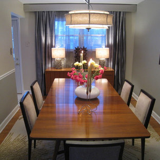 Eclectic medium tone wood floor enclosed dining room photo in Chicago with gray walls