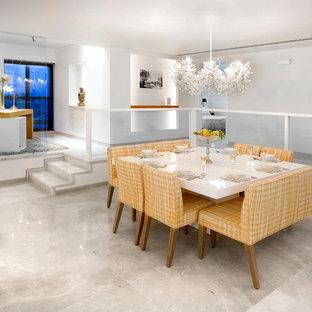 Esempio di una sala da pranzo design con pareti bianche e pavimento con piastrelle in ceramica