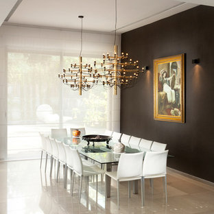 Example of a trendy marble floor and beige floor dining room design in Other with black walls