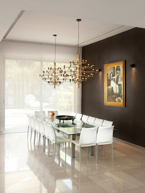 Example of a trendy marble floor and beige floor dining room design in  Other with black