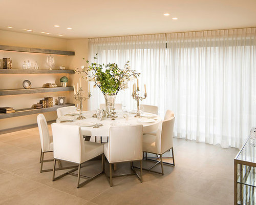 Example Of A Minimalist Dining Room Design In Other With Beige Walls Ceramic Floors And