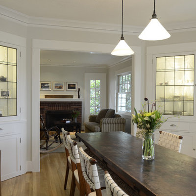 Example of a mountain style medium tone wood floor enclosed dining room design in Portland with gray walls