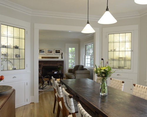 Example Of A Mountain Style Medium Tone Wood Floor Enclosed Dining Room  Design In Portland With