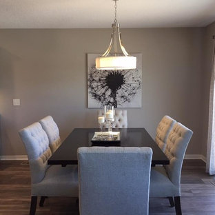 Photo of a medium sized classic kitchen/dining room in Other with beige walls and laminate floors.