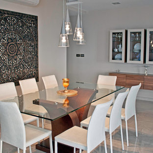 Large trendy porcelain floor kitchen/dining room combo photo in Other with brown walls and no fireplace