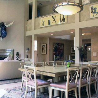 Example of a huge country limestone floor dining room design in New York with beige walls, a standard fireplace and a metal fireplace