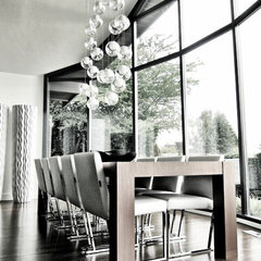 modern dining room by Gaile Guevara
