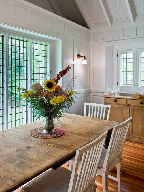 eclectic dining room photo in boston with white walls